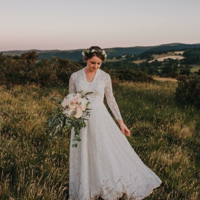 Alice in the Lakes with her romantic bouquet and flower crown